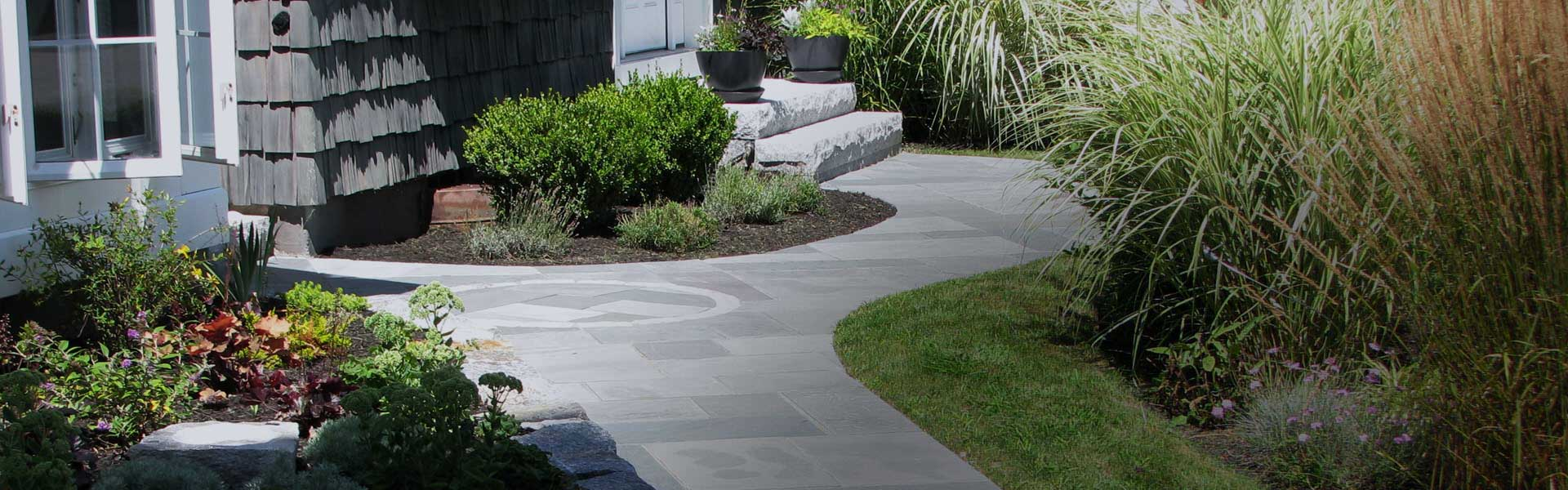 Bluestone walkway with natural stone wall