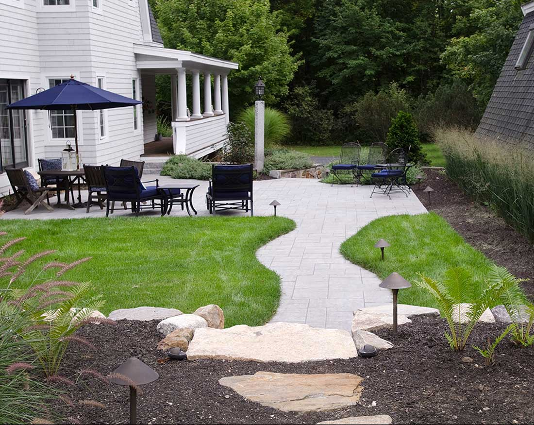 natural flagstone path leads to a Genest Windham Ridge paved walkway