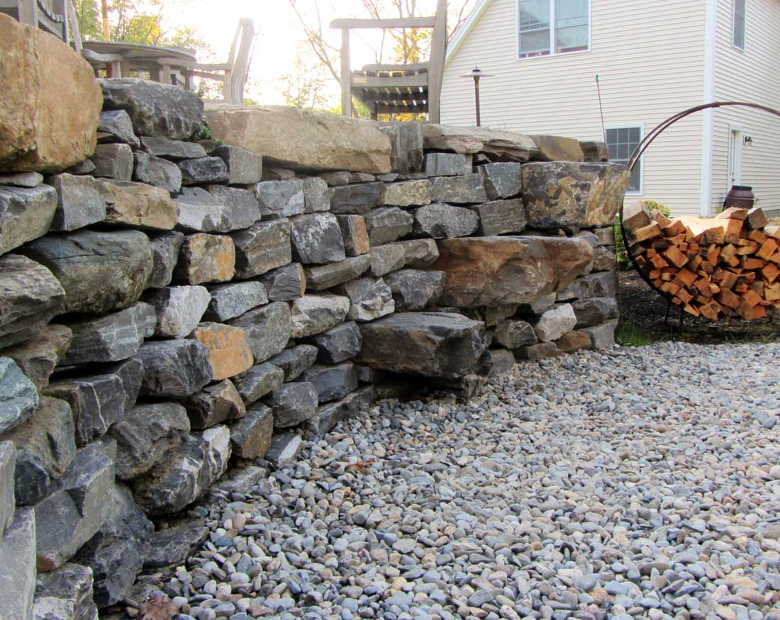 Large stones incorporated into wall to be used as stairs