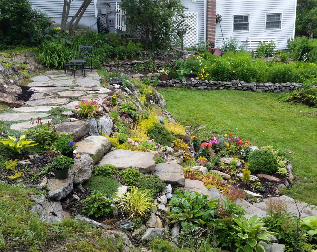 Natural stone steps with flagstone patio